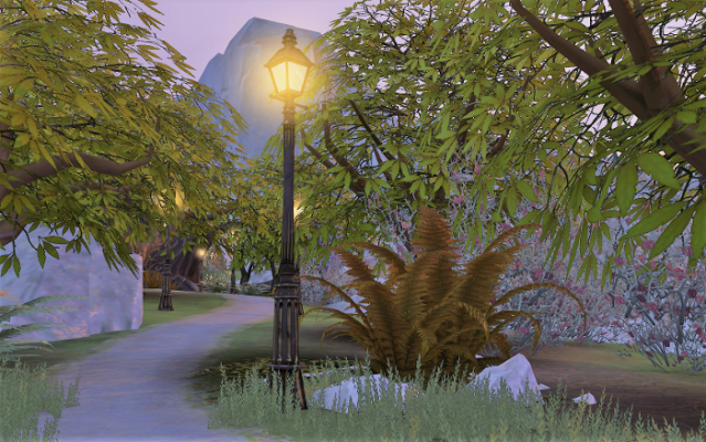 a path at sunset with a glowing street light